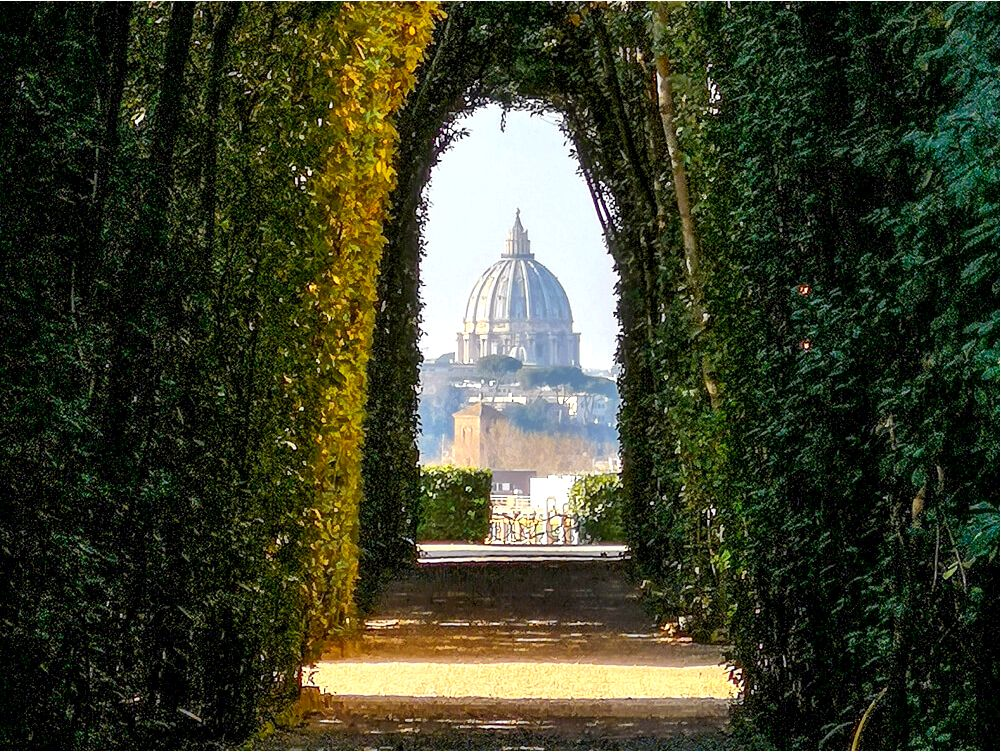 Gate of the priory of the Knights of Malta Keyhole near Orange Garden, Rome, Italy